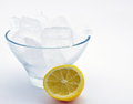 Bowl of ice with lemon a against a light blue background Royalty Free Stock Images