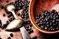 Bowl of juniper berries Royalty Free Stock Photo