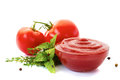 Bowl of ketchup or tomato sauce with ingredients on white Royalty Free Stock Photo