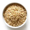 Bowl of long grain brown rice  on white. Royalty Free Stock Photo