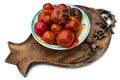 Bowl of marinated tomatoes on wooden carved tray isolated on white Stock Photography