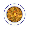 Bowl of mixed vegetable in curry sauce Stock Photos