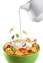 Bowl of muesli and dried fruit isolated on a white background. Royalty Free Stock Photo