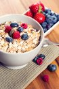 A bowl of muesli with fresh berries healthy on the table Stock Image