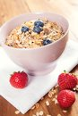 Bowl of muesli with fresh berries and milk a healthy on the table Royalty Free Stock Image
