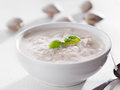 Bowl of new england clam chowder with basil garnish. Stock Photo