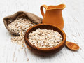 Bowl of oat flake and milk on a wooden background Royalty Free Stock Photography