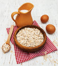 Bowl of oat flake and milk on a wooden background Royalty Free Stock Photos