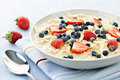 Bowl of oatmeal with berries Royalty Free Stock Photos