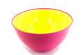 Bowl plastic color pink and yellow on a white background Stock Photo