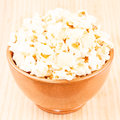 Bowl of popcorn one brown full on wood Royalty Free Stock Photo