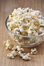 Bowl popcorn snack food a ofpopcorn on a wood table Royalty Free Stock Images