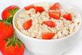 Bowl of porridge oats and strawberries Royalty Free Stock Photos