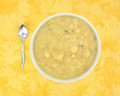 Bowl of potato and leek soup with a spoon Royalty Free Stock Photo