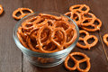 Bowl of pretzels a salted on a wooden table Stock Photography