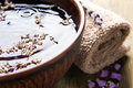 Bowl of pure water and lavender petals on the old Royalty Free Stock Photography