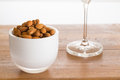 Bowl of raw almond nuts on wooden table Royalty Free Stock Image