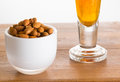 Bowl of raw almond nuts on wooden table Royalty Free Stock Photography