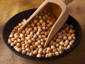 Bowl of raw chickpeas with wooden spoon Royalty Free Stock Photography