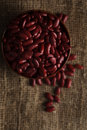 Bowl of red haricot beans on sackcloth. Stock image Royalty Free Stock Photo