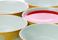 Bowl of red liquid five plates in a row with Stock Image