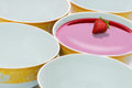 Bowl of red liquid five plates in a row with Royalty Free Stock Image