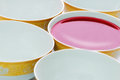 Bowl of red liquid five plates in a row with Stock Photography