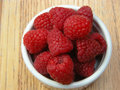 Bowl of red raspberries a juicy are tantalizing with their sweet flavor Royalty Free Stock Photography