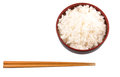 Bowl of rice and chopstick vi a a pair over white background Royalty Free Stock Images
