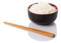 Bowl of rice and chopstick viii a a pair over white background Royalty Free Stock Photo