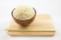 Bowl of rice and chopsticks on wooden Royalty Free Stock Photo