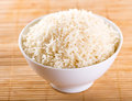 Bowl of rice white on wooden table Royalty Free Stock Images