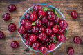 Bowl with ripe cherries on the old wooden background rustic Stock Image