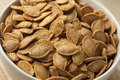 Bowl with roasted pumpkin seeds Royalty Free Stock Photo