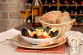 Bowl of seafood soup with wine and rustic bread