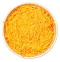Bowl of shredded cheddar over white background Stock Image