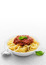 Bowl spaghetti bolognese fork spoon white tablecloth Stock Photos