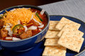 Bowl of spicey chili with crackers Royalty Free Stock Photos