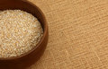Bowl of steel cut oatmeal on burlap bag irish a Royalty Free Stock Photo