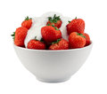 Bowl of strawberries and cream isolated in a against a white background Stock Images
