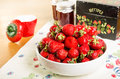 Bowl of strawberries with jam and recipe box fresh a Stock Photo