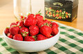 Bowl of strawberries with recipe box a fresh a and a milk bottle Stock Images