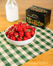 Bowl of strawberries with recipe box a fresh a and a milk bottle Royalty Free Stock Images