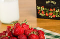 Bowl of strawberries with recipe box a fresh a and a milk bottle Stock Image