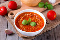 Bowl with tasty tomato soup on wooden board Royalty Free Stock Photo