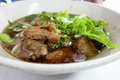 Bowl of thai style pork noodle soup Stock Photos