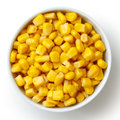 Bowl of tinned sweetcorn isolated from above on white. Royalty Free Stock Photo