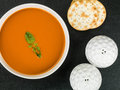 Bowl of Tomato and Basil Soup with Water Biscuit Crackers and Salt and Pepper Royalty Free Stock Photo