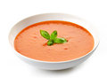 Bowl of tomato soup with basil leaf Stock Photography