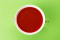 Bowl of tomato soup whole green background Stock Images